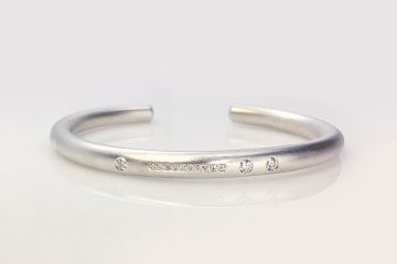 Finding a new life for the stones that were once in a ring, our client chose this Repurposed Diamond Silver Armband based on a similar armband design we created.